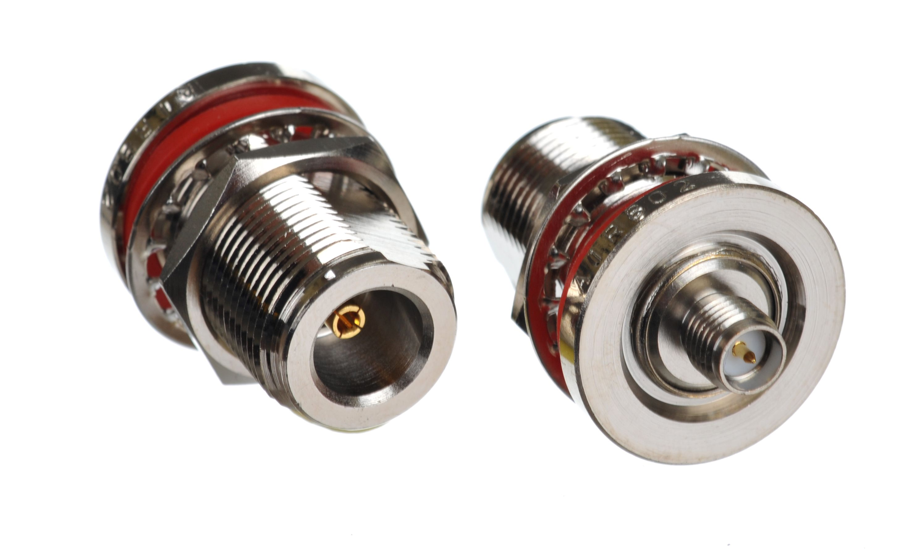 Coaxial inter-series adapter with the left-side showing the N jack-female bulkhead and the right side the RP-SMA jack-female connector.