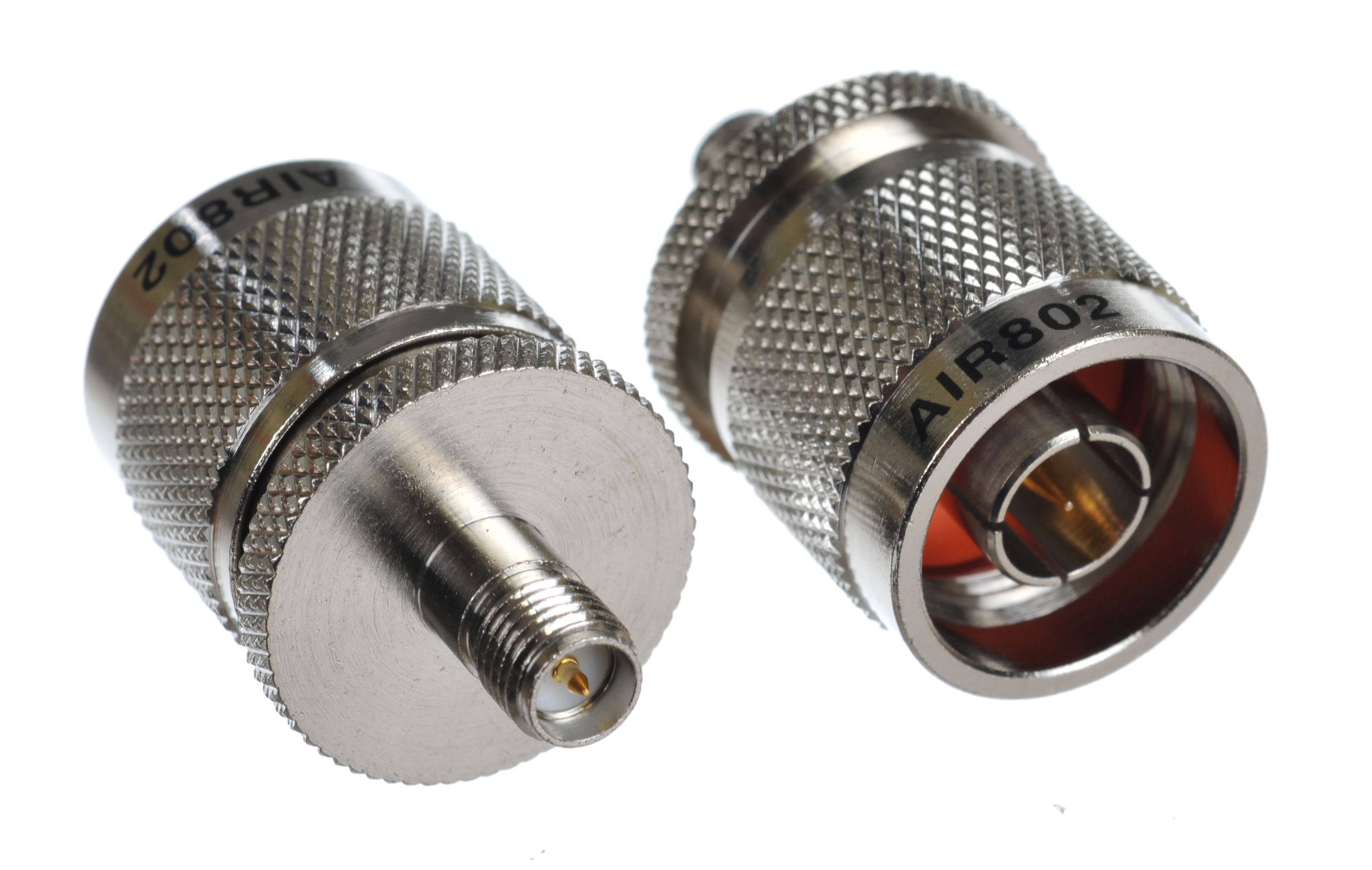 Coaxial inter-series adapter with the left-side showing the RP-SMA jack-female and the right-side the N plug-male connector.