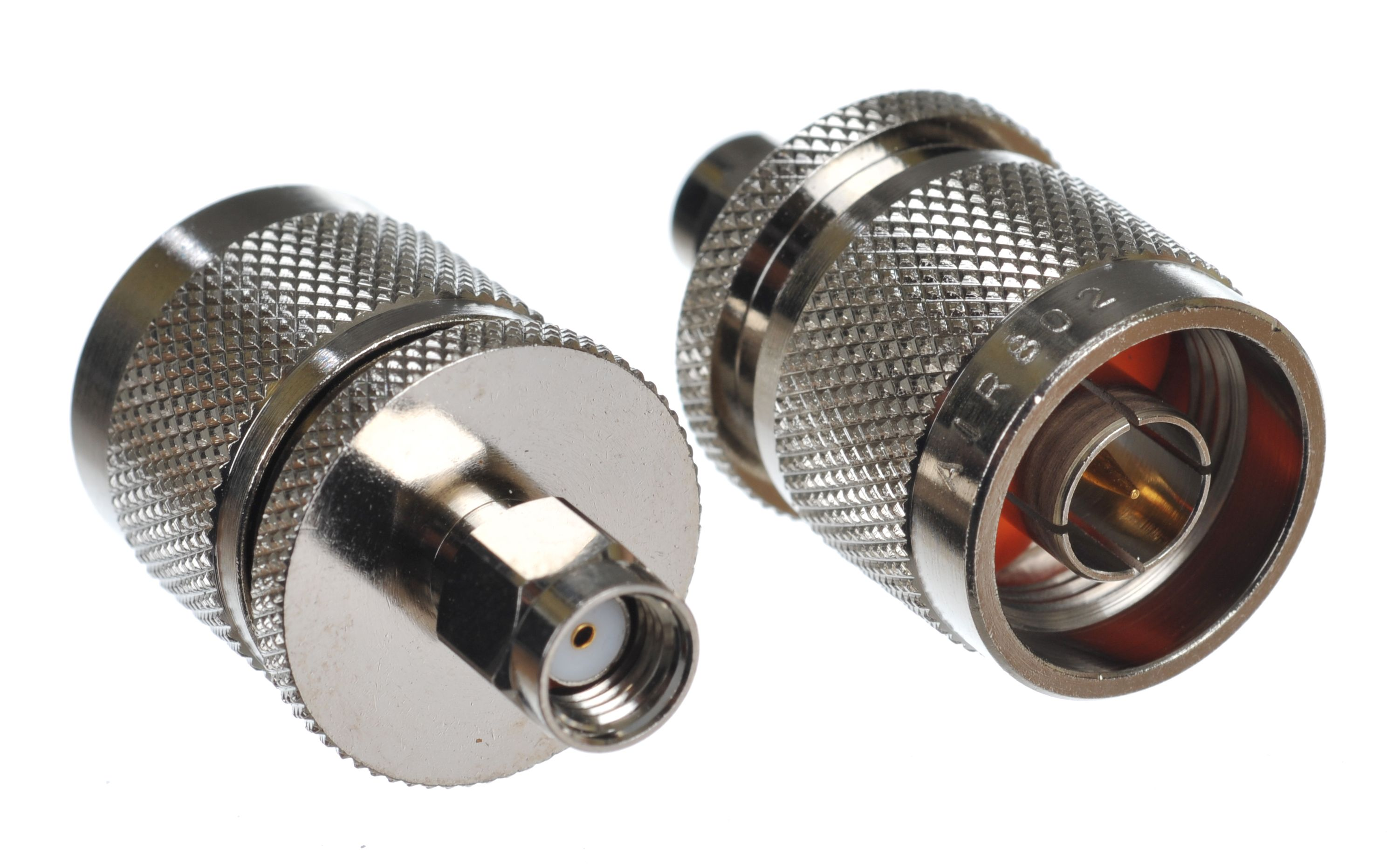 Coaxial inter-series adapter with the left-side showing the RP-SMA plug-male and the right-side the N plug-male connector.